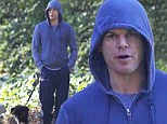 Whistle while you walk! Michael C. Hall takes his dog for a stroll in hoodie and track pants in Los Angeles