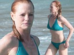 Fabulous at 55! CSI's Marg Helgenberger displays her enviable bikini body while soaking up the sun in St Barts