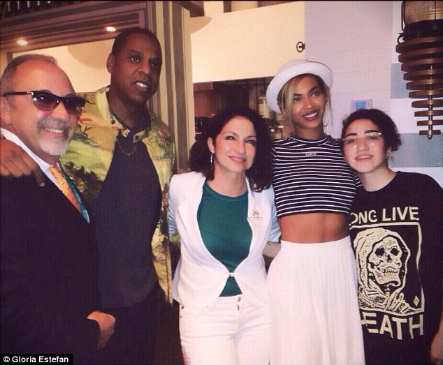 Indulging: Jay Z and Beyonce dined on seafood at Miami hot spot Seasalt and Pepper on Sunday, and afterward took a photo with singer Gloria Estefan and her husband Emilio