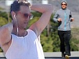Slowly but surely... Matthew McConaughey continues his bid to bulk up once again after movie role weight loss