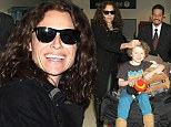 Growing up so fast! Minnie Driver was seen petting her boy Henry as he sat atop a mound of luggage at Los Angeles International Airport on Monday