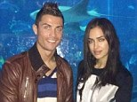 Something fishy going on: Cristiano Ronaldo posed for a picture with his girlfriend Irina Shayk and his son