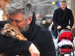 Daddy duty! Alec Baldwin tenderly kisses pet dog and strolls with baby Carmen alongside wife Hilaria