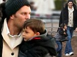 Model dad! Tom Brady cuts a stylish figure in furry jacket and sweater as he bonds with son Benjamin at the park in chilly Boston