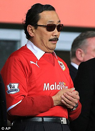 Controversial figure: Cardiff owner Vincent Tan has angered the club's fans by sacking Malky Mackay (right)