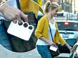 Cameron Diaz gives her outfit an edgy twist with her favourite knuckleduster phone case