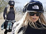 Starting the post-Christmas workout already! Fergie shows off trim figure as she works up sweat on gruelling hike