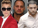 More scandal! Justin Bieber's bodyguards arrested in Miami after 'attacking' a police officer... luckily the singer was miles away in Canada