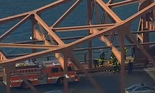 Emergency crews investigate the fatality on the Meridian Street Bridge, which spans East Boston and Chelsea, at about 12:21 p.m. Tuesday