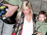 'He'll fight hard for her': Tori Spelling takes off her wedding ring after husband Dean McDermott is accused of cheating but 'he won't let marriage end'