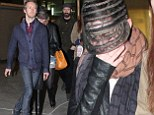 Anne Hat-away! Actress attempts to go incognito on double date night by hiding underneath bizarre sheer baseball cap