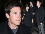 Look smart! Jason Bateman cuts a dapper figure in black coat and grey trousers as he enjoys night out at Chateau Marmont
