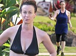 Is it Too Hot to run? Canadian singer Alanis Morissette strips jogging gear and jumps into swimming pool flaunting fabulous body