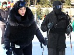 Kim Kardashian hits the slopes in style in a fur-trimmed jacket... but Kanye West looks like the Invisible Man in his head-to-toe cover-up