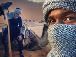 Hump day! Usher shares majestic snaps of himself riding a camel in the Sahara Desert