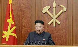 Still in charge: North Korean leader Kim Jong Un delivers a speech during his 2014 New Year address