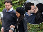 Naomie Harris finally goes public with boyfriend Peter after a YEAR of dating... as pair enjoy tender PDA during Italian break