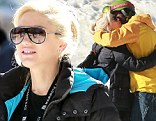 Seal-ed with a kiss: Singer gives pregnant Gwen Stefani a warm greeting as they bump into each other on slopes in Mammoth