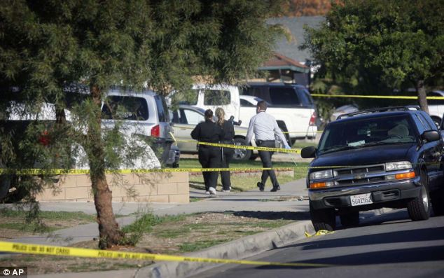 Crime scene: Fontana police arrive at a home on Tuesday where a family of four were found shot to death