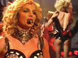 Oops, my clothes are coming off! Britney Spears needs help having sexy top zipped back up during Vegas show