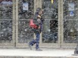Blizzard: A woman battles snow in Wilkes-Barre, Pennsylvania as the country prepares to welcome 2014