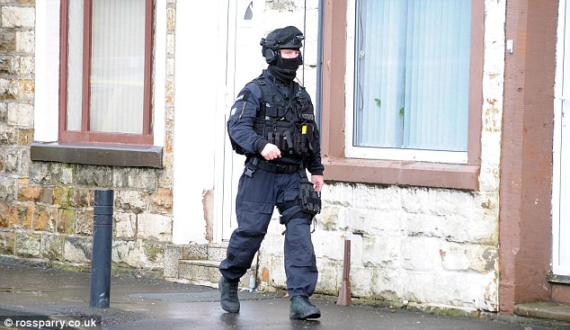 Armed police have been pictured at the scene and the man is talking to police negotiators via telephone
