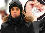 'It was an amazing year!' Kim Kardashian posts picture of baby North holding her diamond engagement ring, while sisters Khloe and Kylie party into 2014