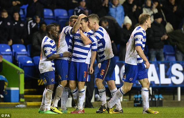 Late goal: Reading's Stephen Kelly (third left) celebrates with his team mates after scoring their side's equalising goal against Nottingham Forest