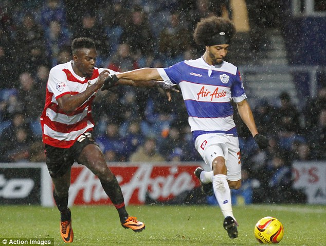 Loan star: Benoit Assou Ekotto (right) could be recalled from his loan spell at QPR by Spurs this month