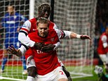 Big moment: Nicklas Bendtner celebrates with Bacary Sagna after scoring his late goal