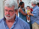 First picture: George Lucas, 69, dotes on his five-month-old daughter Everest as he enjoys family holiday in St Barts