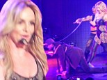 Heel, boy! Britney Spears has boyfriend chained up and on a leash as he joins her on stage for New Year's Eve gig