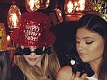 Khloe Kardashian opts for red sparkly hat and silly glasses as she welcomes in new year with sister Kylie Jenner