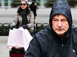 30 (degree) Rock! Bare-legged Alec Baldwin pedals around in shorts while wife Hilaria bundles up on family stroll in chilly New York