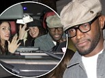 Enjoying the single life? Taye Diggs pictured leaving nightclub with group of women after recent split from wife Idina Menzel