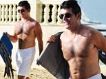Simon Cowell shows off toned physique in white shorts as he jumps on a jet ski in Barbados