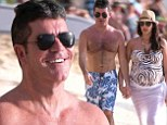 What a difference a year makes! Simon Cowell ends 2013 with a romantic beach stroll in Barbados with pregnant girlfriend