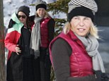 Taking it easy: Chelsea Handler visits friends on the slopes without her skis... just one day after an injury left her bandaged and bed-ridden