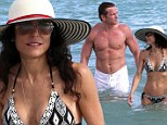 Bikini clad Bethenny Frankel puts divorce troubles behind her to enjoy a dip with hunky mystery man at Miami Beach