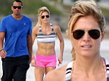 Better hit the gym A-Rod! Torrie Wilson shows up her professional sportsman beau baring her ab-tastic stomach on the beach