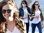 Happy New... cheer? Kristen Stewart beams as she prepares to see in 2014 with her friend and dogs by stocking up on organic goodies