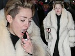 So that's her secret! Miley Cyrus is spotted spritzing her tongue with throat spray ahead of performance in Times Square