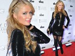 Paris Hilton pulls out all the stops for New Year's Eve DJ set in plunging figure-hugging dress