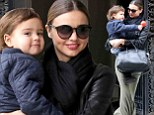 He may only be half Aussie but he's full koala! Adorable Flynn snuggles into mum Miranda Kerr like a little bear