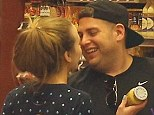 Kissing couple: Jonah Hill moves in for a kiss as he shopped for groceries with his rumoured new love on Monday in Los Angeles