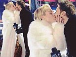 'Thank you for having me!' Miley Cyrus is thrilled after sharing New Years smooch with Ryan Seacrest