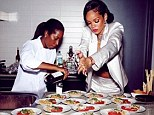 Getting into the swing of it: Rihanna took to the kitchen in her new NYC penthouse apartment to create a spectacular dinner for nearly 20 of her closest friends on New Year's Eve