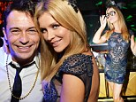 Too cool: Joanna Krupa turned on the heat while posing for photos during a New Year's Eve bash at the nightclub her husband Romain Zago owns in Miami - Mynt