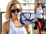 Last workout of 2013! Kate Hudson shows off her slim figure in eye-catching red leggings as she hits the gym on New Year's Eve