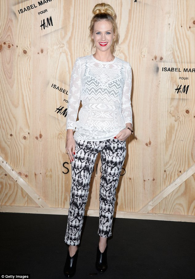 Ruined: January Jones looked fabulous in a pair of printed cropped trousers and a see through white top as she attended the launch of the Isabel Marant for H&M collection but her hair ruined the look